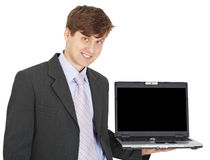 Friendly smiling person holds laptop on hand. Friendly smiling person holds the laptop on a hand isolated on white Stock Photo