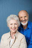 Friendly smiling senior couple stock photography