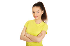 Friendly smiling woman with crossed arms. Royalty Free Stock Photo