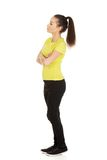 Friendly smiling woman with crossed arms. Royalty Free Stock Photos
