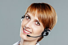 Friendly smiling woman with headset Stock Photos