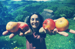 Friendly smiling woman holding apples in her hands Stock Image
