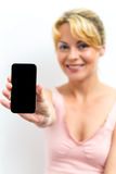 Friendly smiling woman holding up her mobile Royalty Free Stock Photos