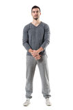 Friendly smiling young sporty fit man with clasped hands looking at camera. Full body length portrait isolated on white studio background Stock Photos