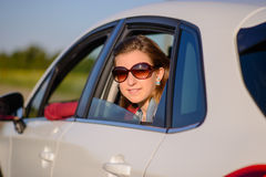 Friendly smiling young woman in a car Stock Photo