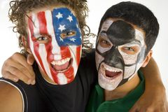 Friendly soccer fans. Two American fan in the friendly embrace. They're looking at camera. Front view. Closeup on face Stock Photos
