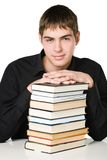 Friendly student. Photo of a friendly student wit books, isolated on white Royalty Free Stock Photos