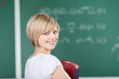 Friendly student looking back at the camera Stock Photography