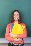 Friendly student or teacher clutching a her files Royalty Free Stock Image
