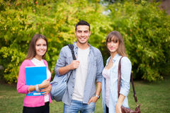 Friendly students at the park Royalty Free Stock Images