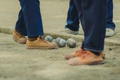 Friendly Students playing petanque at school. royalty free stock photos