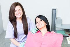 Friendly and successful female dentist doctor and patient. Friendly and successful female dentist doctor and smiling women patient stock image