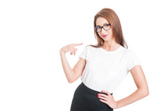 Friendly successful woman pointing finger at her Stock Photo