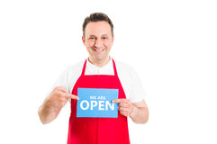 Friendly supermarket employee holding open sign Royalty Free Stock Photo