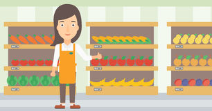Friendly supermarket worker. Royalty Free Stock Images