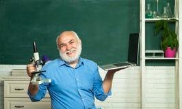 Friendly teacher in classroom near blackboard desk. Tutoring. World teachers day. Thank You Teacher. Professor in class