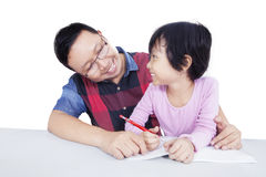 Friendly teacher helps student to study Royalty Free Stock Photography