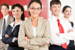 Friendly team. Portrait of several smiling business partners with their leader in front Stock Photos