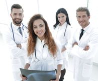 Friendly team of doctors at the hospital. Stock Photo