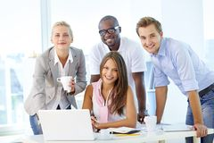 Friendly team. Friendly young people working as a business team Royalty Free Stock Photo