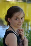 Friendly teenage girl. Portrait of a cute  teenager girl with pearl necklace Stock Images