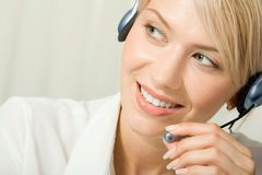Friendly telephone operator Royalty Free Stock Photography