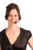 Friendly telephone operator. Friendly attractive brunette female switchboard operator Stock Photo