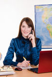 Friendly travel agent talking on the phone Stock Photos