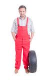 Friendly and trustworthy mechanic standing with hands in pockets Royalty Free Stock Photos