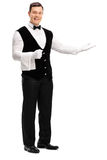 Friendly waiter greeting someone Stock Photography