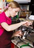 Friendly waitress making coffee Stock Photos