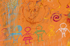Friendly on-wall graffity. On-wall graffiti symbolizing diversity and friendship between people Royalty Free Stock Photo
