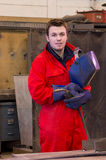 Friendly welder looks at camera Stock Images