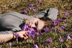 Friendly woman. Woman in a crocus field stock photos