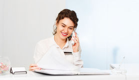 Friendly woman behind reception desk administrator Royalty Free Stock Photography