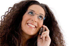 Friendly woman busy with phone call Royalty Free Stock Photography