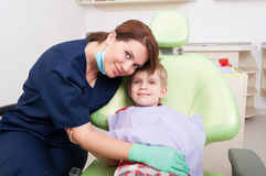 Friendly woman dentist concept. Friendly women dentist concept with happy and relaxed kid or child patient Royalty Free Stock Photography