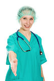Friendly woman doctor extends his hand Royalty Free Stock Photography