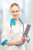 Friendly woman doctor smiling with Stock Images