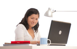 Friendly woman at her desk Stock Photography