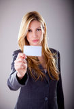 Friendly woman holding a business card stock photography