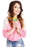 Friendly Woman Holding Ice Cream and Smiling Stock Photography