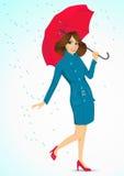 Friendly woman holding an umbrella Stock Photo