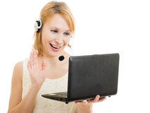 The friendly woman operator with a laptop Stock Photos