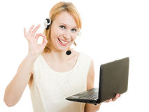 The friendly woman operator with a laptop Royalty Free Stock Images