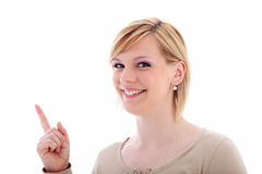 Friendly woman pointing to blank copyspace Stock Images