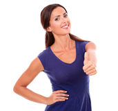 Friendly woman in purple dress with ok sign Stock Photography