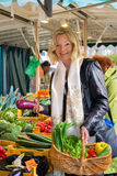 Friendly woman shopping for fresh vegetables Royalty Free Stock Image