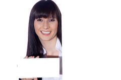 Friendly woman with sign Royalty Free Stock Photos