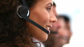 friendly woman smiling on a customer support team stock footage